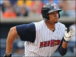 Toledo Mud Hens CF Daniel Fields singles for an RBI against the Norfolk Tides during the fourth inning.