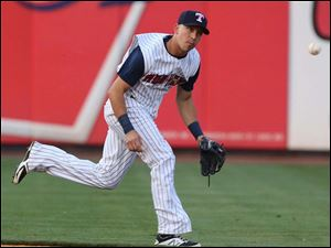 Toledo Mud Hens SS Hernan Perez makes a play against the Norfolk Tides during the third inning.