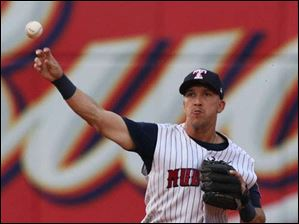 Toledo Mud Hens SS Hernan Perez makes a play against the Norfolk Tides during the fourth inning.