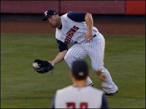 Mud Hens left fielder Tyler Collins makes a run and grab catch during game against Norfolk.