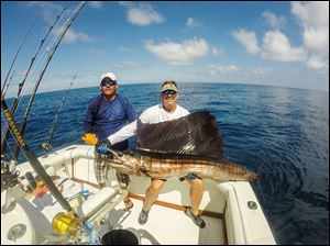 Toledo angler Scott Kozak shows off a Pacific sailfish he caught off Guatemala in December, 2013. The Whitmer grad is pictured with one of the mates.