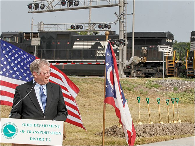 n7mccord-4 Lucas County Engineer Keith Earley speaks at the groundbreaking for the McCord Road underpass project on Friday in Holland. Construction is expected to be completed in 2016.