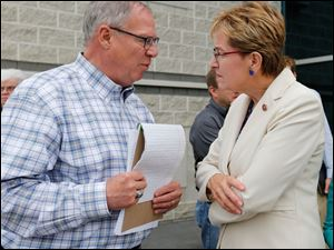 Toledo Mayor D. Michael Collins speaking with  Rep. Marcy Kaptur (D-Oh.)  outside the Lucas County EMA building in Toledo, Ohio.