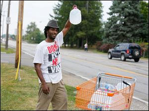 Isaac Miles, Toledo, sells water on Lewis Avenue, north of Laskey. Mr. Miles had purchased the water in Taylor, Mi., and brought it back to use and sell.