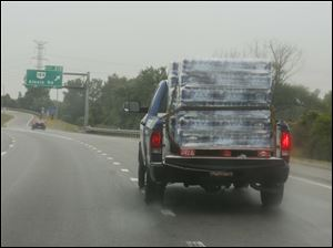 A truck loaded with bottled water exits at I-75 after driving down from Michigan.