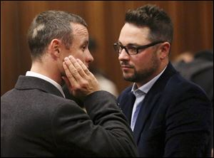 "Carl Pistorius, right, has been ""badly hurt"" in a car accident after a head-on collision on a highway in South Africa."