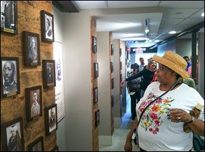 Toledo resident Deborah Foreman, 61, studies the portraits of American abolitionists that line the walls.