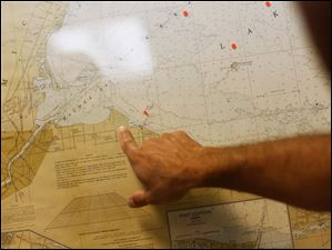Paul Roman, director of public service, points to a map at the Oregon Water Plant.