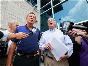 Ohio Gov. John Kasich, left, and Mayor D. Michael Collins speaks to the media after a closed door meeting to address the water emergency in Toledo.