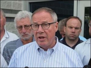 Toledo Mayor D. Michael Collins gives an update on water testing during a news conference Sunday in Toledo.