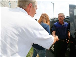Senator Randy Gardner (R) - District 2, shakes hands with Ohio Gov. John Kasich, right, as he leaves after a closed door meeting with Mayor D. Michael Collins and other dignitaries to address the water emergency in Toledo.