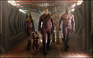 From left, Zoe Saldana, the character Rocke