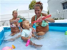 ROV-WaterRoverConnie-Elter-left-and-Dawn-Szych-right-play-with-Myah-Brown-center-11-mo