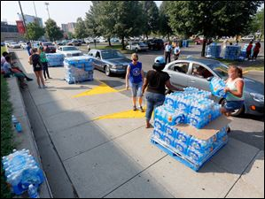 Water distribution continues at Central Catholic High School.