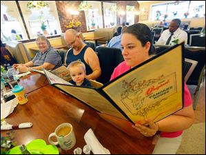 April Chappell, right, and her son Ross Chappelle, 2, check out the menue at The Original Pancake House.