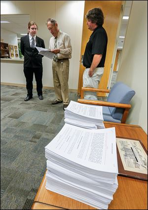 Sean Nestor, left, and Ken Sharp, right, of Northwest Ohio NORML, talk with Toledo Clerk of Council Jerry Dendinger.