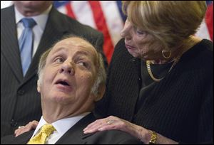 Former White House press secretary James Brady, left, who was left paralyzed in the Reagan assassination attempt, looking at his wife Sarah Brady, during a news conference on Capitol Hill in March, 2011.