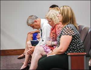 Family members of Emilee Gagnon, including her father, John Gagnon, left, and her aunt, Ann Marie Osmer listen to the proceedings in Ottawa County Municipal Court. Miss Gagnon was on her way to San Francisco to raise funds for multiple sclerosis. She was to stop in Perrysburg for the night.
