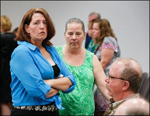 Lynne Smith, left, with her sister-in-law, Kim Ingram, said the sun blinded her, and she did not see bicyclist  Emilee Gagnon, 24.  Ms. Smith was put on probation for two years and fined on Monday.