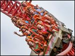 Riders enjoy the Maverick roller coaster at Cedar Point amusement park in Sandusky.
