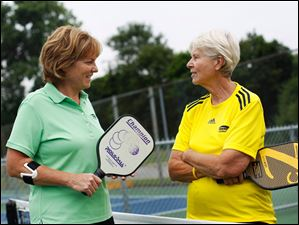 Marsha Koch, left, and Connie Mierzejewski, right, talk before a match.