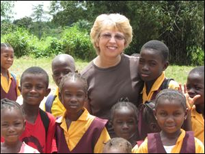 Nancy Writebol with children in Liberia in October, 2013. Writebol is one of two Americans working for a missionary group in Liberia that have been diagnosed with Ebola.