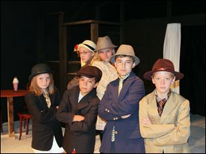 Elle Hurst, Tanner Strock, Carter Rodriguez, and Charlie Herrman, front row, and Alice Momany and Abbie Fricke, in back row, are among cast members in the Young Rep's presentation of '‍Bugsy Malone, Jr.' today through Sunday.