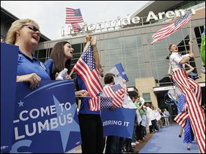 A crowd at Nationwide Arena welcomes a Democratic National Committee team.