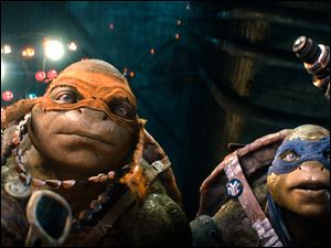 "Raphael (left) and  Michelangelo in a scene from ""Teenage Mutant Ninja Turtles."""