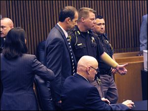 Theodore Wafer, left, is lead out of the courtroom after being found guilty of of second-degree murder.