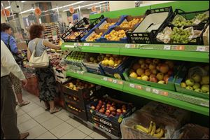 People buy imported fruit at a supermarket in downtown Moscow today. The Russian government has banned all imports of meat, fish, milk and milk products and fruit and vegetables from the United States, the European Union, Australia, Canada and Norway.