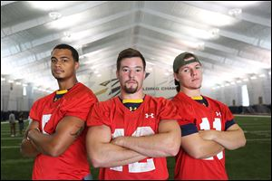 Toledo's Michael Julian, left, Phillip Ely, center, and Logan Woodside are vying to be this year's starting quarterback.