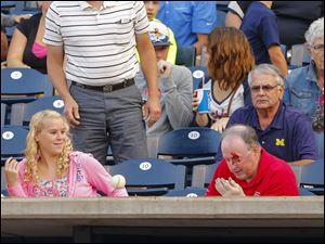 A fan comes up bloody after being hit by a foul ball during the fourth inning.