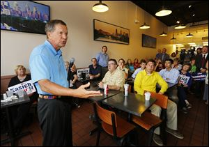 Gov. John Kasich campaigns at Mr. Spots restaurant in Bowling Green.