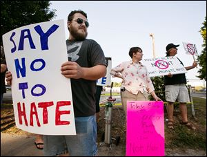 Dan Denton of Toledo and others protest outside the Ted Nugent concert.