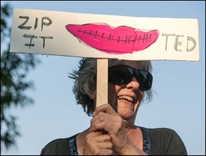 Carole Jambard-Sweet of Maumee protests outside the Ted Nugent concert.