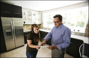 Realtor Greg Gammonley, right,  shows off a home to  Maddie Coker in Orlando, Fla. A report suggests that the recession did little to turn off millennials from the idea of owning a home.