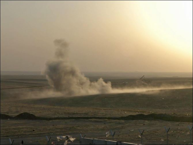 Smoke rises from airstrikes targeting Islamic State militants near the Khazer checkpoint outside of the city of Irbil today in northern Iraq.