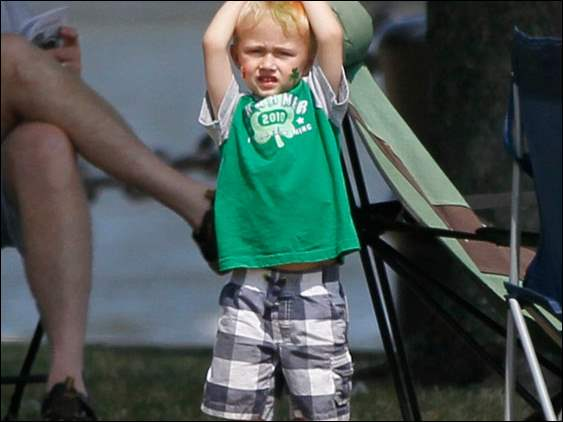 "Carter ""Sauce"" Cox, 3, of Toledo, watches as his father retrieves his balloon in the park."
