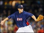 Pitcher Jim Johnson gave up two runs in two-thirds of an inning Friday night in his first appearance with the Mud Hens.