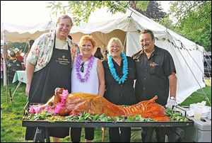 Hosts Sharon and Michael Sordyl with Tracy and Bruce Sabo at the luau.