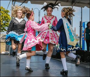From left, Mary Catherine Scarlet, 16, of Maumee, Chianna Kujawa, 9, of Toledo, Jessica Reighard, 14, of Perrysburg, and Lindsey Lazor, 9, of Perrysburg, perform as part of Molly's Irish Dancers and the Perrysburg Dance Academy.