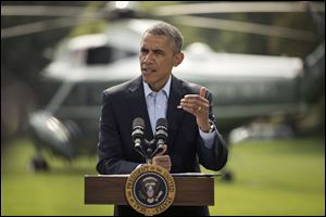 President Barack Obama speaks on the South Lawn of the White House today in Washington.