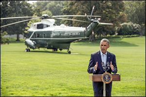 President Obama speaks to the media on the South Lawn of the White House on Saturday.