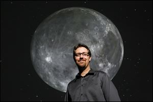 Michael Cushing, professor of physics and astronomy at the University of Toledo, inside the Ritter Planetarium where he is the director.