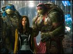 From left, Michelangelo, Leonardo, Megan Fox as April O'Neil, Raphael, and Donatello in a scene from