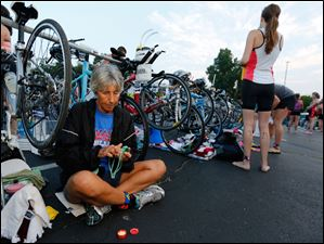 Cheryl McCormick of Toledo prepares her goggles before the triathlon begins.