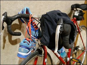 Some of the gear needed to compete in a triathlon include running shoes, a bicycle, and a swimsuit.