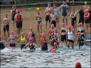 Sprint triathlon women 35 years-old and over start their 0.25-mile swim in Olander Lake.