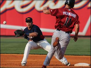 Toledo shortstop Hernan Perez makes a play against  Lehigh Valley baserunner Cameron Perkins during the second inning.